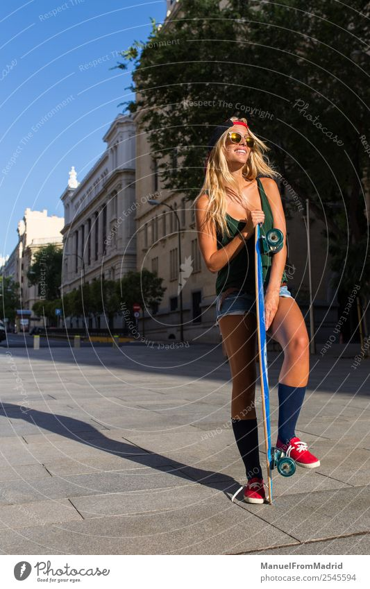 young skater woman in the street Lifestyle Style Beautiful Summer Woman Adults Street Fashion Blonde Smiling Stand Cool (slang) Hip & trendy casual Skateboard