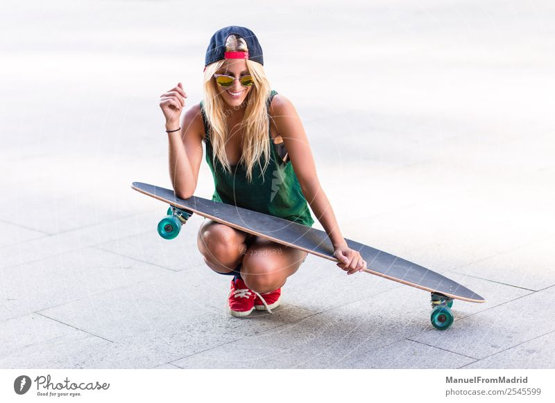 young skater woman in the street Lifestyle Style Joy Beautiful Summer Woman Adults Downtown Street Sunglasses Blonde Smiling Cool (slang) Eroticism Hip & trendy