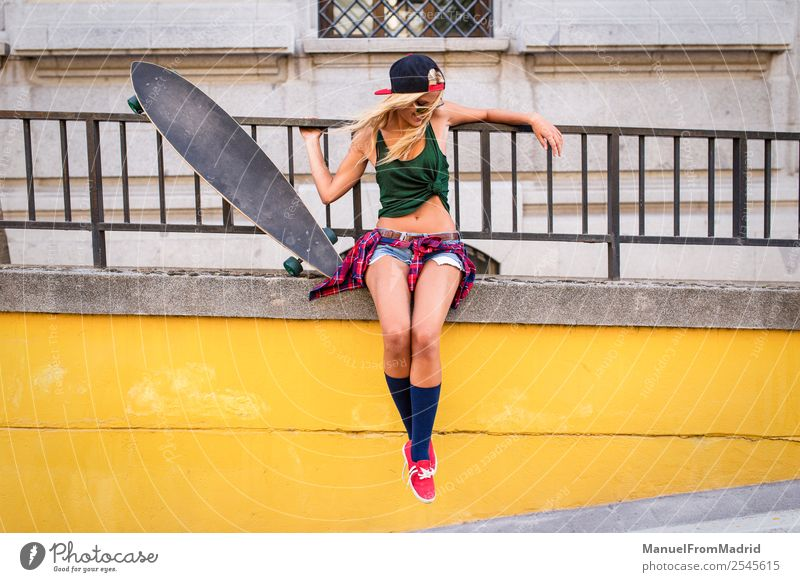 attractive young skater woman looking down Lifestyle Style Joy Beautiful Summer Woman Adults Downtown Street Sunglasses Blonde Smiling Cool (slang) Eroticism