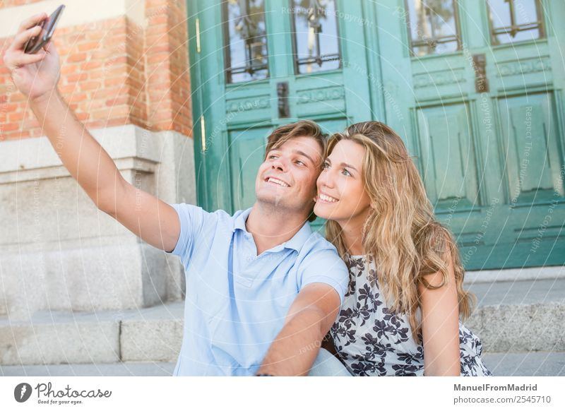 young cheerful couple taking a selfie Lifestyle Joy Happy Beautiful Leisure and hobbies Vacation & Travel Summer Telephone Camera Woman Adults Man Couple