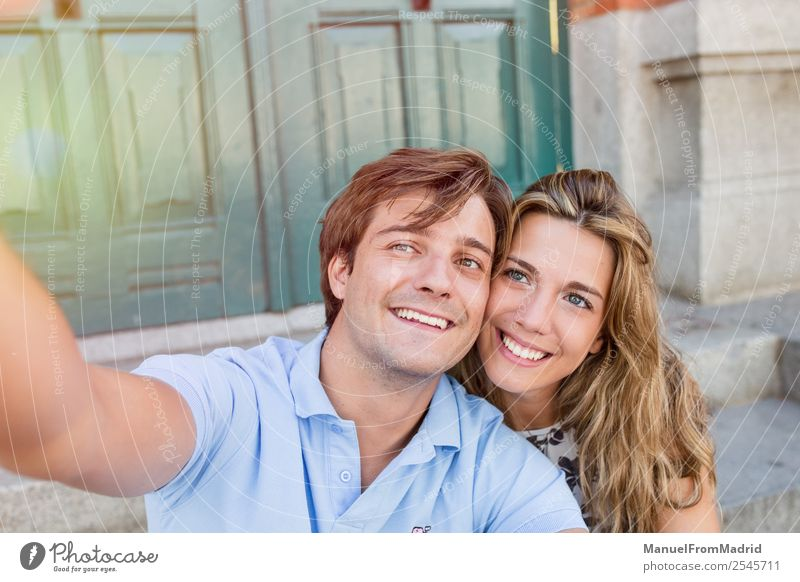 young couple taking a selfie Lifestyle Joy Happy Beautiful Leisure and hobbies Vacation & Travel Summer Telephone Camera Woman Adults Man Couple Smiling Love