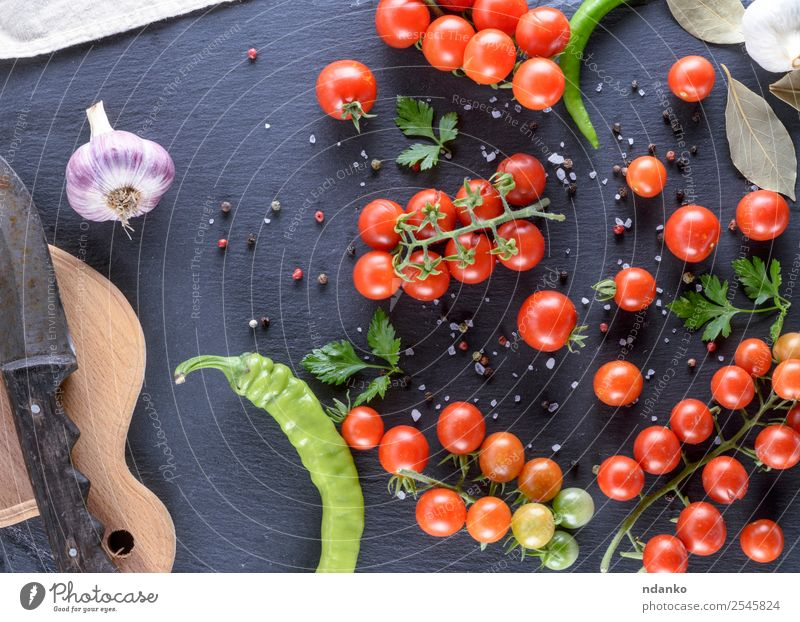 Ripe red cherry tomatoes Vegetable Herbs and spices Knives Wood Fresh Above Red Black Colour Tradition food Tomato Cherry Mature round background Raw dry Tasty