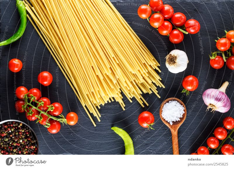 Uncooked pasta spaghetti Vegetable Dough Baked goods Wood Line Fresh Large Long Above Yellow Red Black Colour Tradition Spaghetti food Tomato Cherry Sauce