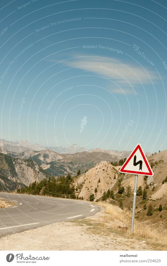 Warning sign in curve in front of alpine panorama Road sign Environment Nature Landscape Beautiful weather Trip Alps Mountain Curve Peak Transport Tilt