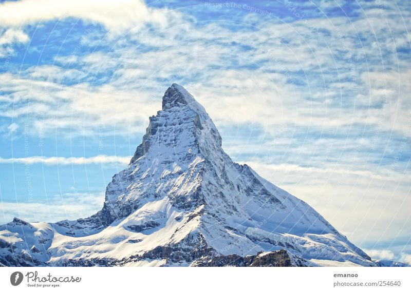 Sky Vacation & Travel Blue Landscape Far-off places Winter Mountain Snow Rock Weather Ice Tall Point Climate Peak Frost
