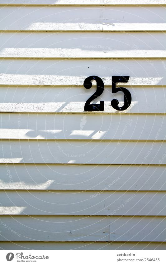 25 Digits and numbers House number Addressee Mail Ranking House (Residential Structure) Wooden house Facade Light Shadow 2525 Birthday Jubilee