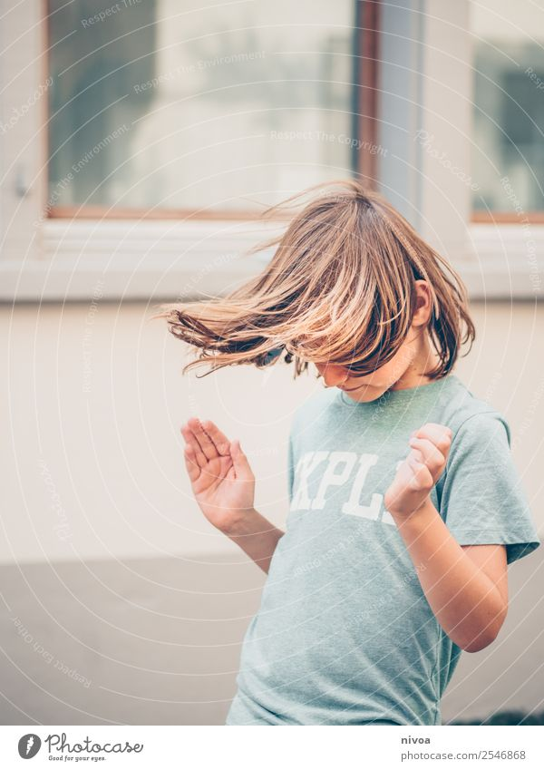 long-haired boy makes hula hoop Leisure and hobbies Hula hoop Sports Fitness Sports Training Parenting Child Schoolchild Human being Masculine Boy (child) 1