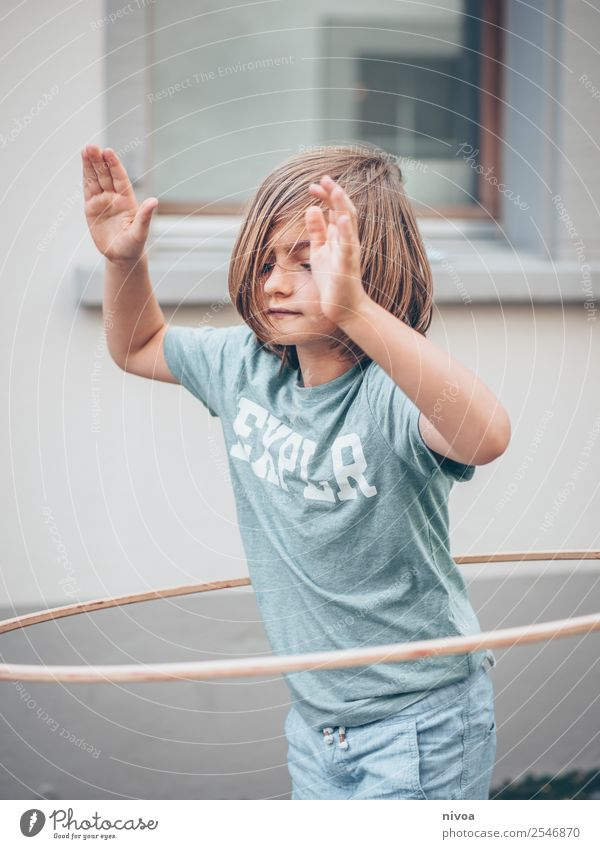 Boy with long hair makes Hulahoop Life Summer Sports Hula hoop Schoolchild Human being Masculine Boy (child) 1 8 - 13 years Child Infancy Beautiful weather Town