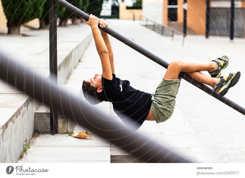 Brave child hanging from a park bar Child Human being Summer Colour Joy Lifestyle Healthy Sports Movement Happy Boy (child) Small Playing Leisure and hobbies