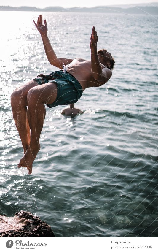 Man Back-Flipping On A Beach Water Joy sea Ocean Sand backflip Summer Relaxation Freedom Vacation & Travel Action Acrobat Surf Happy Flying Sports Colour photo