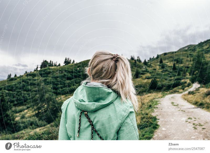 Thoughtful girl Freedom Mountain Hiking Feminine Young woman Youth (Young adults) 18 - 30 years Adults Nature Landscape Autumn Alps Jacket Sportswear Blonde