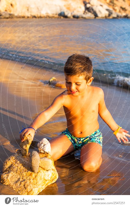 Little kid making constructions with stones on the beach Child Human being Vacation & Travel Summer Blue Sun Ocean Joy Beach Lifestyle Coast Happy Building