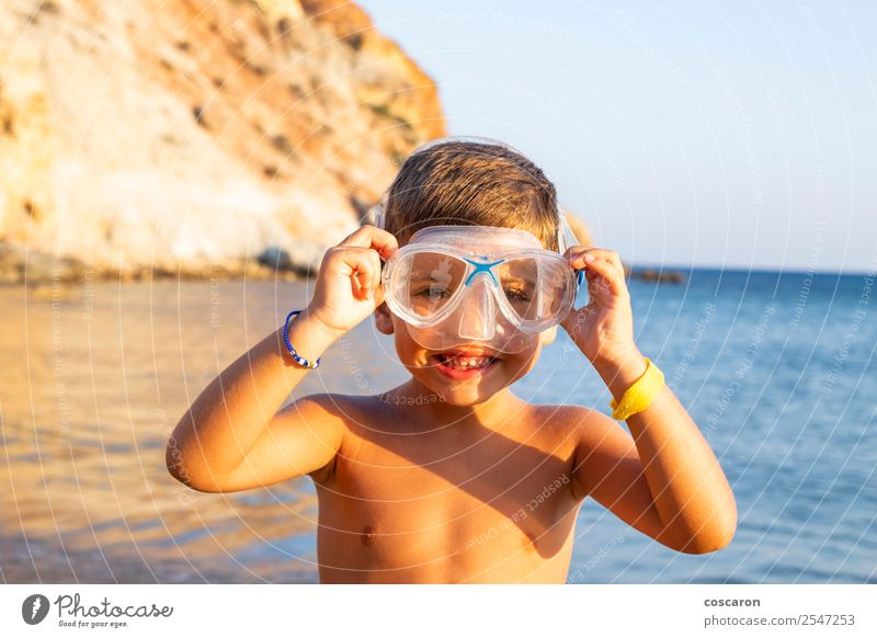 Kid with diving goggles on the shore of the ocean Child Human being Vacation & Travel Summer Blue White Ocean Relaxation Joy Beach Lifestyle Sports