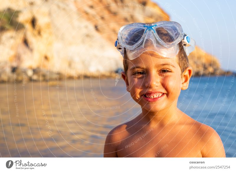 Kid with diving goggles on the shore of the ocean Lifestyle Joy Happy Relaxation Swimming pool Leisure and hobbies Vacation & Travel Summer Beach Ocean Sports