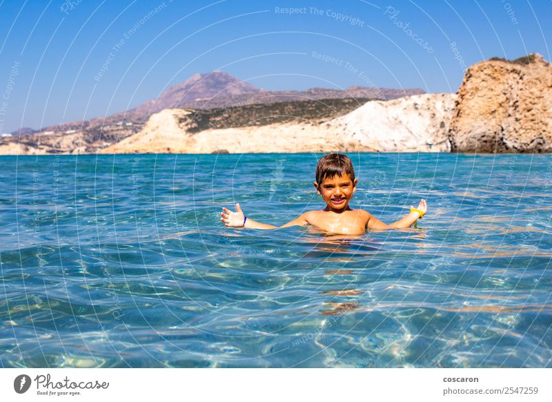 Little boy floating on the sea with transparent water Child Human being Sky Nature Vacation & Travel Youth (Young adults) Summer Blue Beautiful Water White