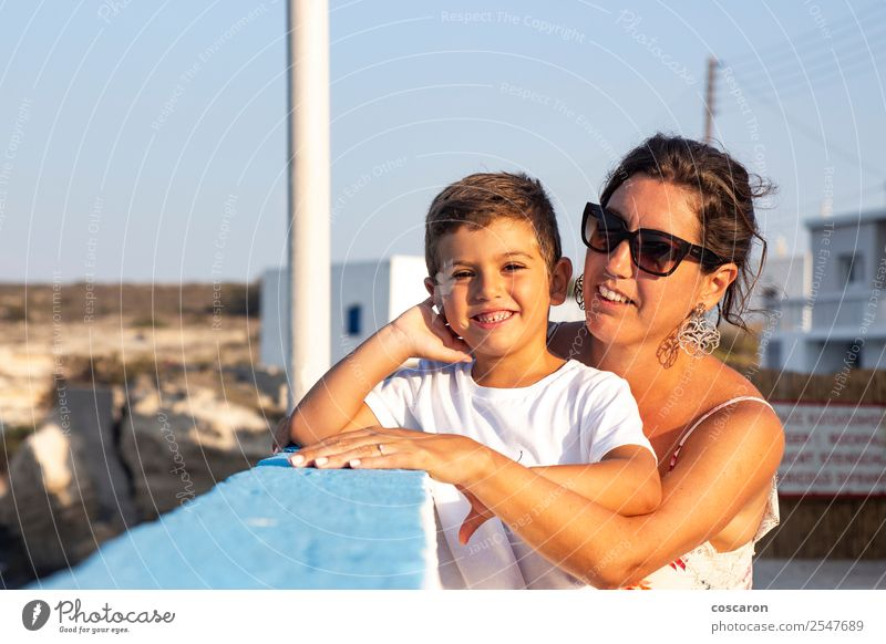 Mother and son together outdoors at summer Woman Child Human being Sky Vacation & Travel Summer Blue Beautiful Landscape White Joy Eating Lifestyle Adults Love