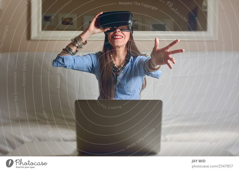 Woman experiencing virtual reality in home Human being House (Residential Structure) Lifestyle Adults Happy Playing Freedom Living or residing