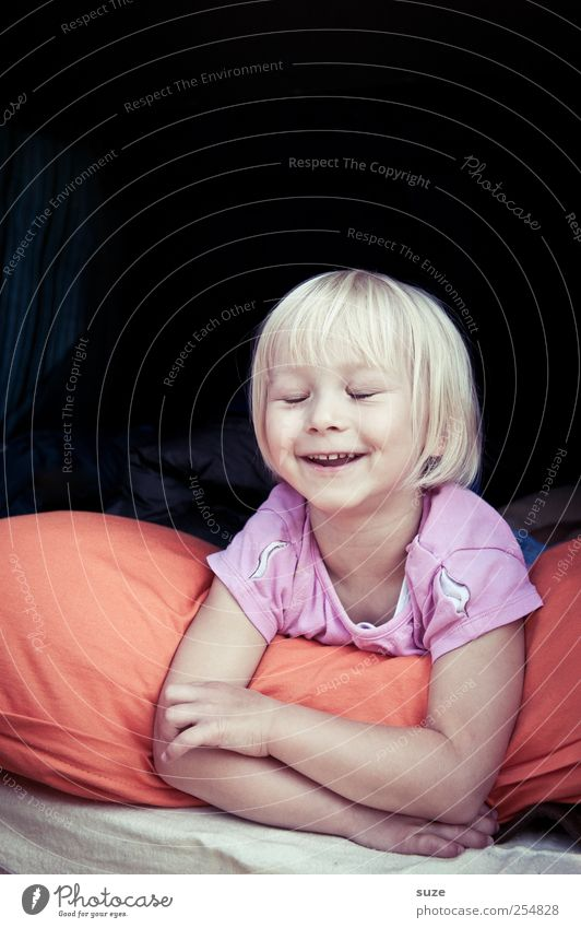 Human being Child Face Hair and hairstyles Laughter Head Blonde Infancy Lie Happiness Smiling Toddler Joie de vivre (Vitality) Cushion 3 - 8 years Closed eyes