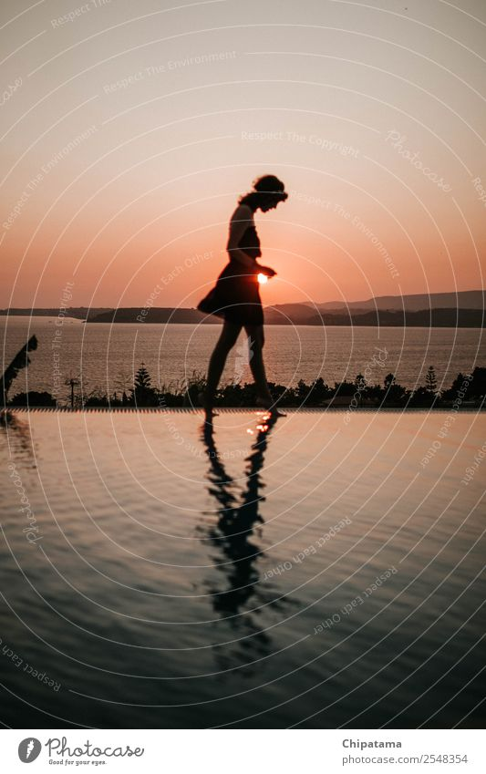Happy Carefree Woman Enjoying Beautiful Sunset on the Pool Young woman Youth (Young adults) Success Fitness Nature Vacation & Travel sunset water reflection