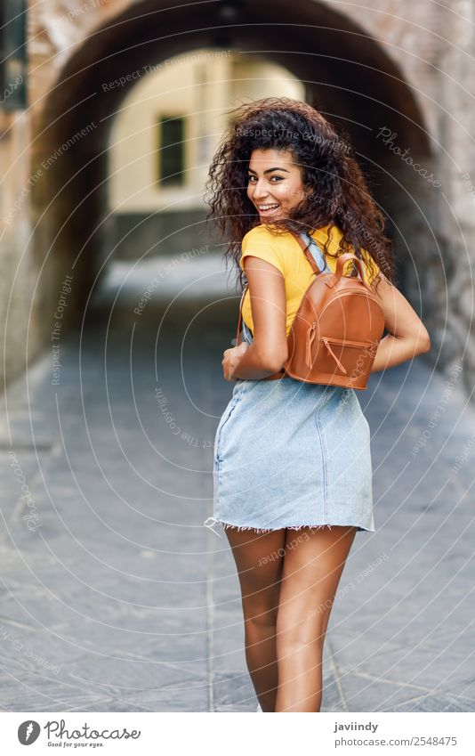 Rear view of smiling black tourist woman with curly hair Woman Human being Youth (Young adults) Young woman Beautiful Joy 18 - 30 years Black Face Street