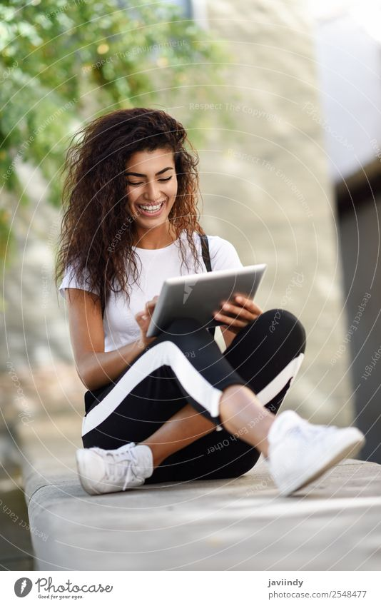 Young African woman with looking at her digital tablet Woman Human being Youth (Young adults) Young woman Beautiful Joy 18 - 30 years Black Street Lifestyle