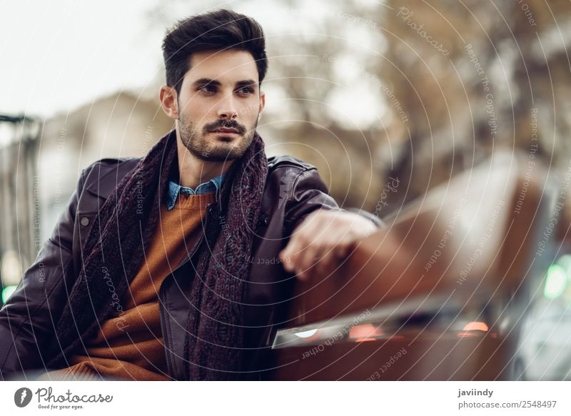Thoughtful young man sitting on an urban bench. Lifestyle Style Beautiful Hair and hairstyles Human being Masculine Young man Youth (Young adults) Man Adults 1
