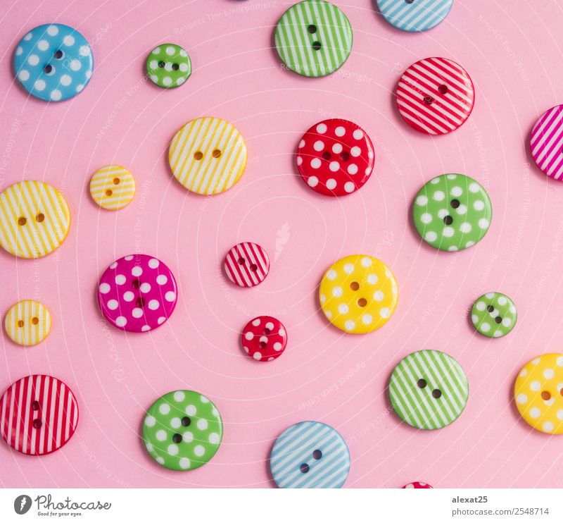 Colorful bottons on pink background Design Craft (trade) Group Fashion Clothing Accessory Collection Plastic Old Happiness Funny Retro Blue Yellow Green Pink