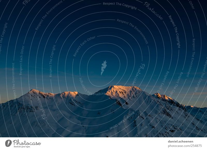 The last one turns off the light! Vacation & Travel Adventure Winter Snow Winter vacation Mountain Alps Peak Snowcapped peak Blue Switzerland Copy Space top