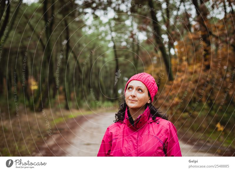 Matured woman with wool pink hat in the forest Lifestyle Beautiful Freedom Winter Hiking Human being Woman Adults Nature Autumn Tree Leaf Park Forest