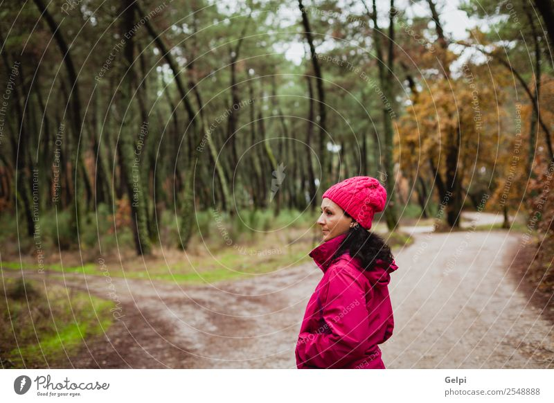 Matured woman Lifestyle Beautiful Freedom Winter Hiking Human being Woman Adults Nature Autumn Tree Leaf Park Forest Lanes & trails Fashion Hat Brunette Long