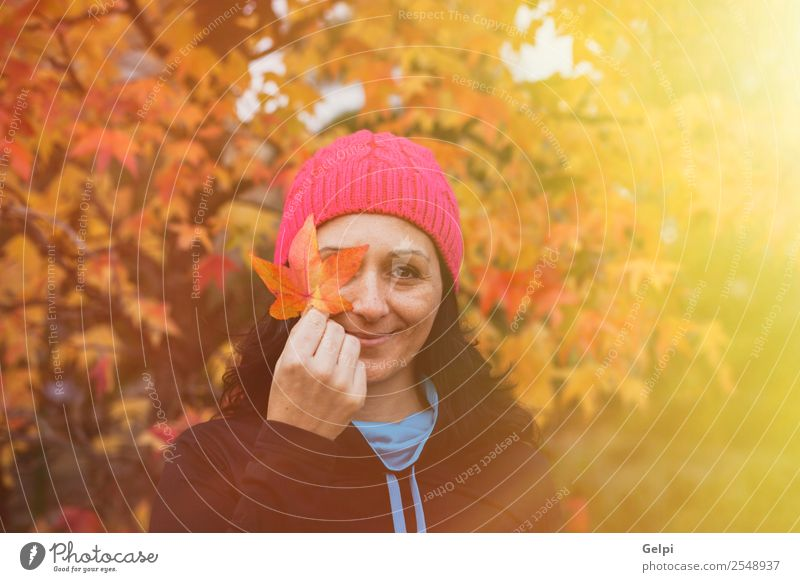 Matured woman with pink wool hat in the forest Lifestyle Beautiful Face Freedom Human being Woman Adults Nature Autumn Tree Leaf Park Forest Fashion Hat