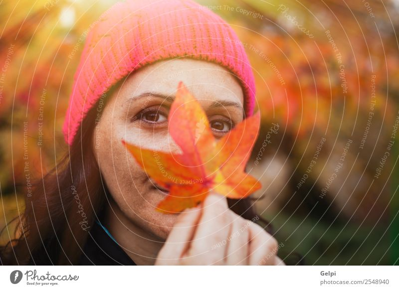 Matured woman Lifestyle Beautiful Face Freedom Human being Woman Adults Nature Autumn Tree Leaf Park Forest Fashion Hat Brunette Long Natural Cute Gold Pink