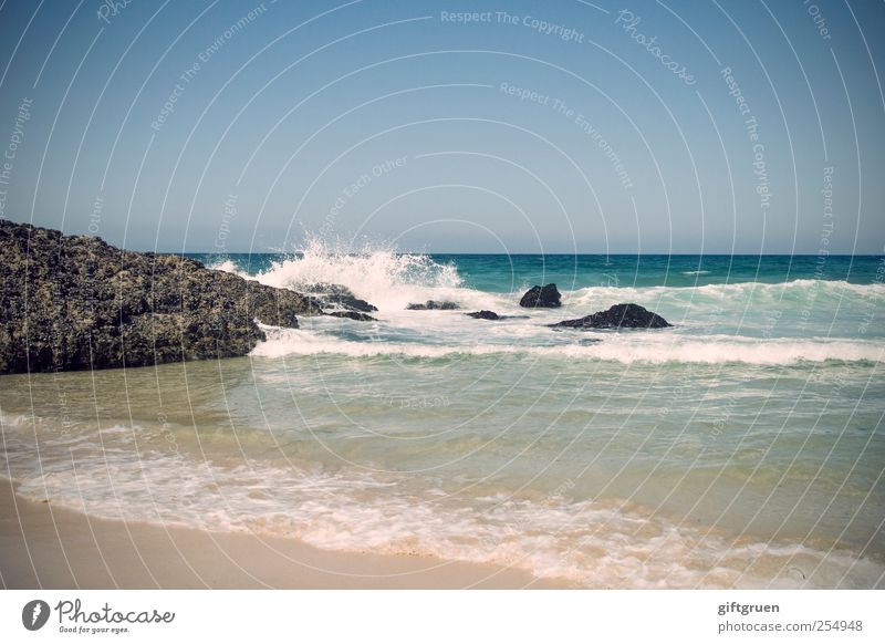 rock'n'roll Environment Nature Landscape Elements Water Drops of water Sky Cloudless sky Beautiful weather Rock Waves Coast Bay Ocean Island Blue Surf Inject