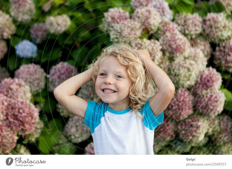 Cute small child with long hair in the garden Happy Beautiful Face Summer Garden Child Human being Baby Boy (child) Man Adults Infancy Hand Environment Nature