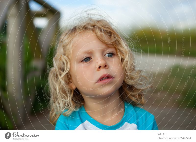 Small child with long blond hair enjoying of a sunny day Happy Beautiful Face Summer Child Human being Baby Boy (child) Man Adults Infancy Environment Nature