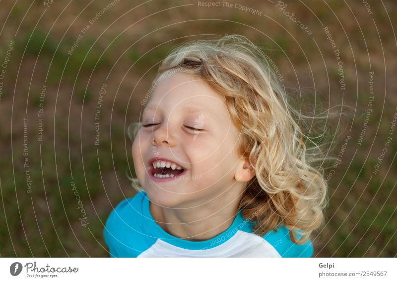 Small child with long blond Happy Beautiful Face Summer Child Human being Baby Boy (child) Man Adults Infancy Environment Nature Plant Blonde Smiling Long Funny
