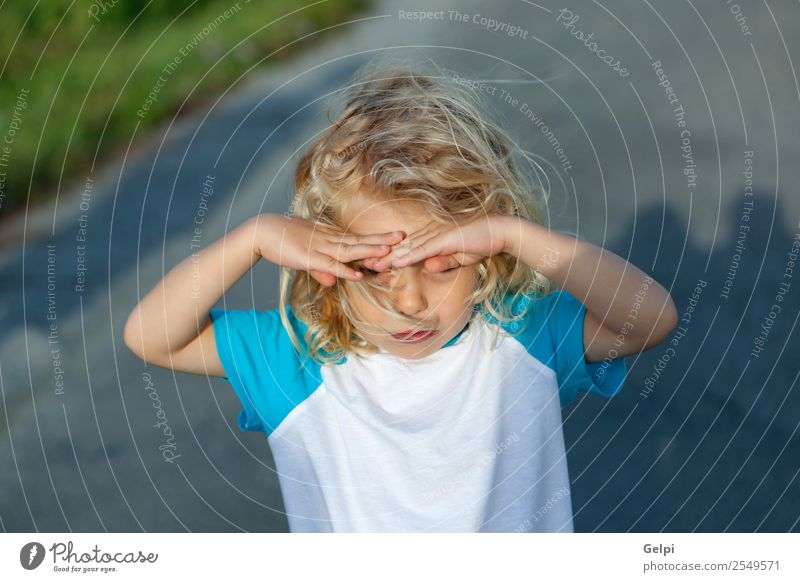 Little boy covering his eyes by the sun, on a sunny day Beautiful Face Summer Sun Child Human being Baby Boy (child) Man Adults Infancy Hand Environment Nature