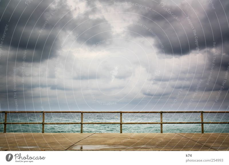 14-piece sea Sky Clouds Storm clouds Horizon Weather Bad weather Coast Ocean Stone Water Threat Strong Anger Colour photo Subdued colour Exterior shot