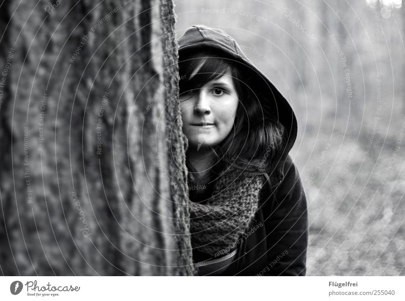 Inconspicuous? Feminine Young woman Youth (Young adults) 1 Human being Looking Hide Forest Tree Insecure Scarf Autumn Hooded (clothing) Shallow depth of field