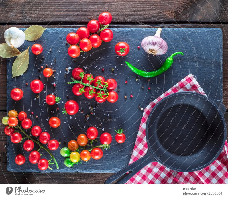 pan and ripe red cherry tomatoes Vegetable Herbs and spices Vegetarian diet Pan Summer Kitchen Wood Eating Fresh Small Natural Above Green Red Black Cherry