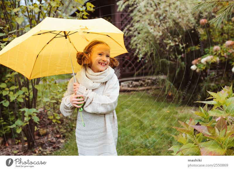 happy kid girl hiding under umbrella Lifestyle Joy Happy Garden Child Infancy Nature Autumn Weather Rain Park Sweater Drop Funny Wet Cute Yellow fall walk