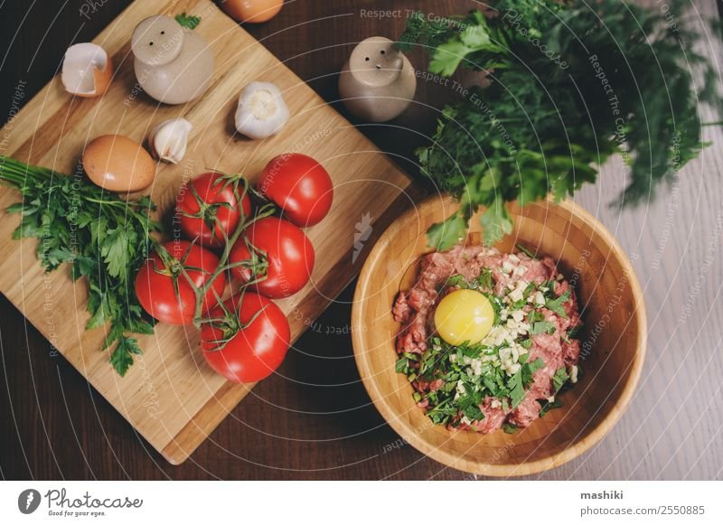Raw minced meat with egg, herbs and fresh tomatoes Meat Vegetable Nutrition Plate Bowl Kitchen Fresh Beef ball loaf prepare Hamburger Garlic Heap pepper