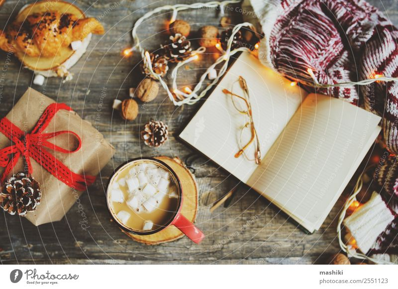 weekly planner or to do list top view with Christmas decorations Hot Chocolate Coffee Winter Decoration Table New Year's Eve Couple Book Warmth Wood