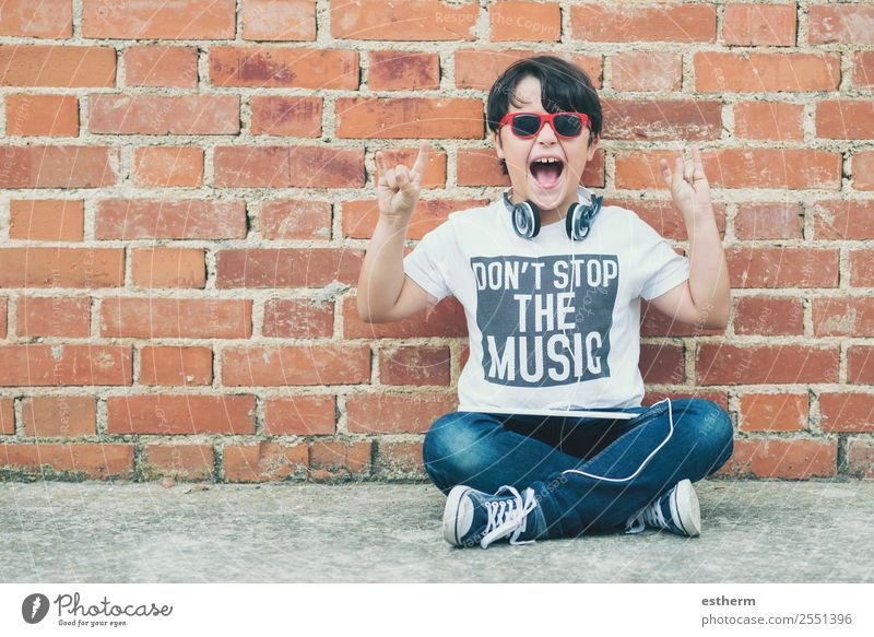 child with headphones connected with digital tablet Child Human being Joy Lifestyle Emotions Boy (child) Playing Masculine Modern Technology Music Infancy