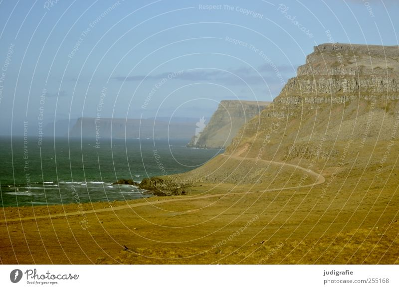 Sky Nature Water Ocean Environment Landscape Mountain Lanes & trails Coast Waves Earth Rock Natural Wild Hill Iceland
