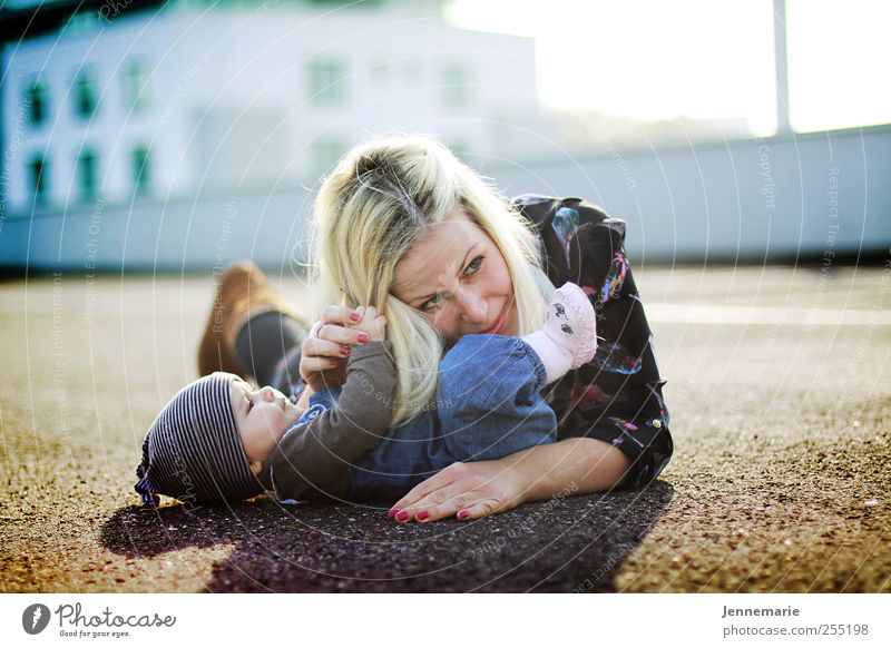 Human being Beautiful Joy Adults Happy Bright Funny Together Blonde Baby Lie High-rise Happiness Crazy Mother Family & Relations