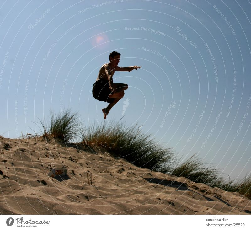 Kiss the sky Jump Ocean Grass Man Sky Sand Beach dune Air grap Aviation Trick jump