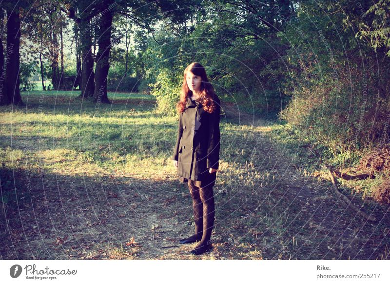 Somewhere in the middle, it hurts. Human being Young woman Youth (Young adults) 1 18 - 30 years Adults Environment Nature Autumn Tree Grass Forest Clothing Coat