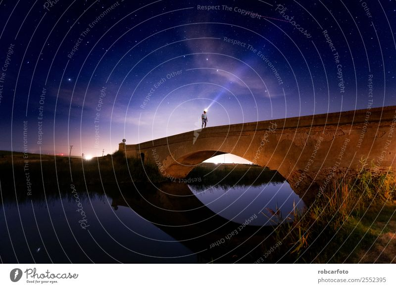 Man crossing bridge in the countryside at night Design Vacation & Travel Woman Adults Sky Town Bridge Building Architecture Transport Street Overpass Line