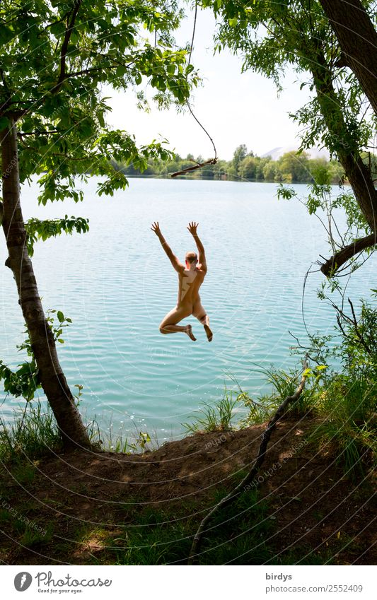 Naked young adult jumps from a rope into a lake Joy Leisure and hobbies Freedom Summer Swimming & Bathing Masculine Young man Youth (Young adults) 1 Human being